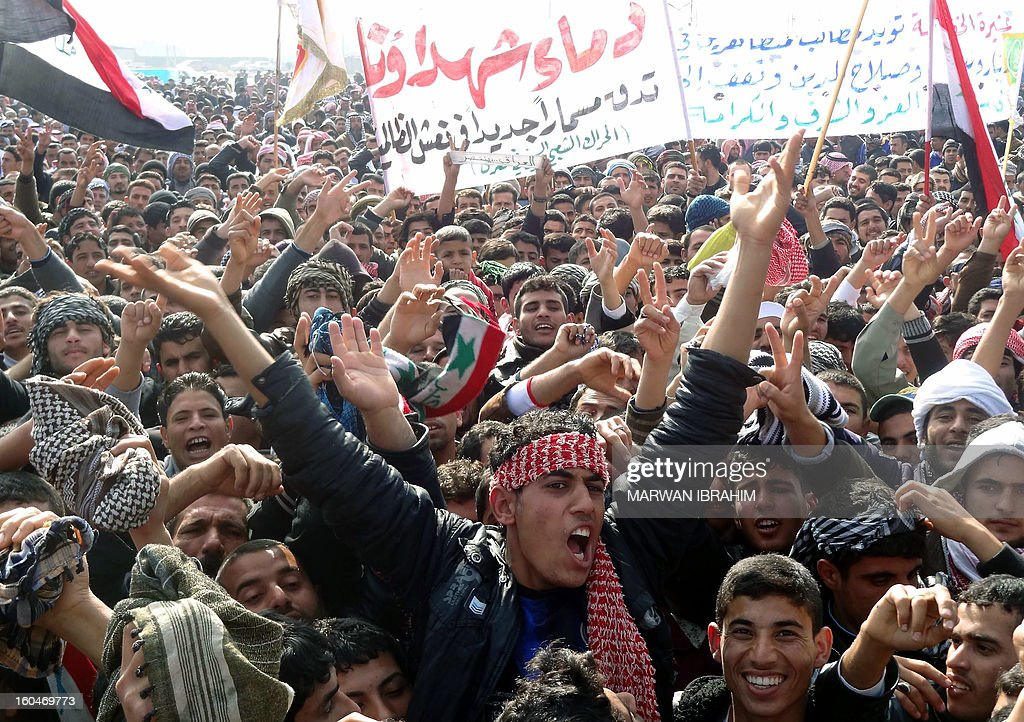 Iraqi demonstrators shout slogans during an anti-government protest in the ethnically mixed city of Kirkuk, 240 kms (150 miles) north of Baghdad, on February 1, 2013. Thousands of Sunni Muslims took to the streets of Iraq to call for the ouster of the country's Shiite Prime Minister Nuri al-Maliki and decry the alleged targeting of their minority.