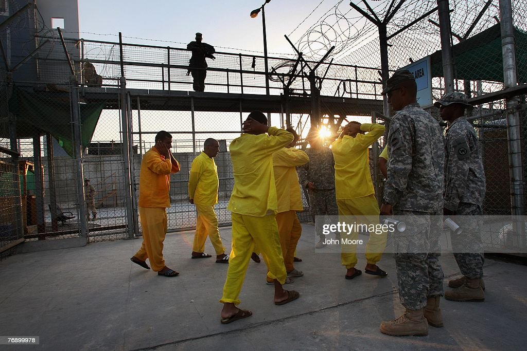Iraqi detainees are moved by U.S. Army guards through the Camp Cropper detention center September 20, 2007 in Baghdad, Iraq. The U.S. military has a total of about 25,000 detainees in several centers in Iraq, up from only about 14,000 before the American troop surge this year. The detainee population includes more than 800 juveniles, insurgents from all anti-coalition groups in Iraq, Al Qaeda foreign fighters, criminals, and many innocent Iraqis caught up in U.S. military raids. Military officials say they have instituted a new review process to more quickly identify the innocent detainees for release.