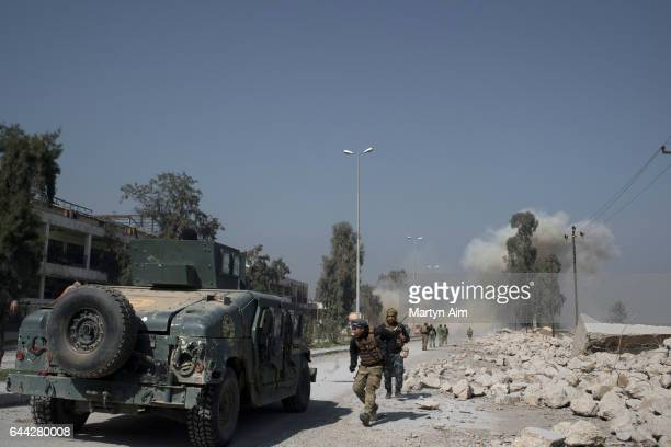 Iraqi Emergency Response Division soldiers run from mortar fire as they advance on the Islamic State occupied Mosul Airport in west Mosul part of the...