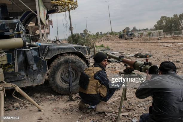Iraqi Emergency Response soldier aims an RPG grenade launcher at an Islamic State position during their advance into Bab alTob a neighbourhood in the...
