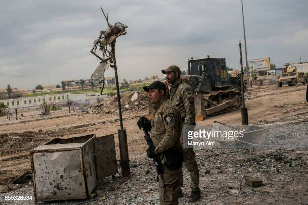 Iraqi Emergency Response soldiers advance into Bab alTob a neighbourhood in the Old City of west Mosul part of the offensive to retake the city some...
