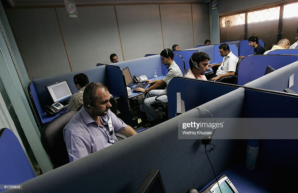 Iraqi employees of Zain Mobile Phone Company are seen at their call centre on June 26, 2008 in Baghdad, Iraq. The war-damaged aging landline telephone infrastructure means Iraqis are increasingly more dependent on mobile phones in daily life and business.