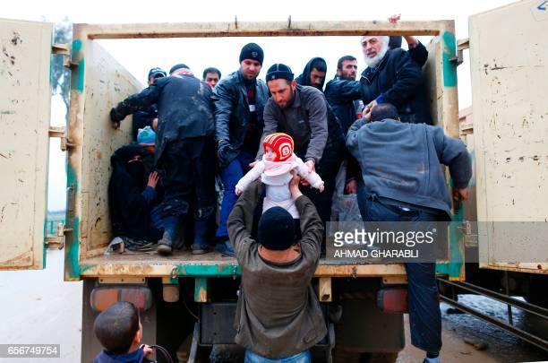 TOPSHOT Iraqi families fleeing fighting between Iraqi forces and jihadists of the Islamic State group are evacuated on March 23 2017 in Mosul Iraqi...