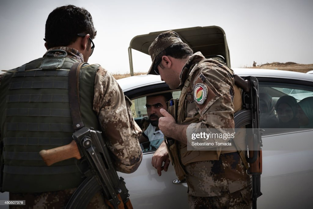Iraqi families fleeing violence arrive at a Kurdish checkpoint.June 12, 2014.