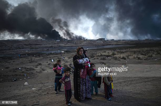 Iraqi families who were displaced by the ongoing operation by Iraqi forces against jihadists of the Islamic State group to retake the city of Mosul...