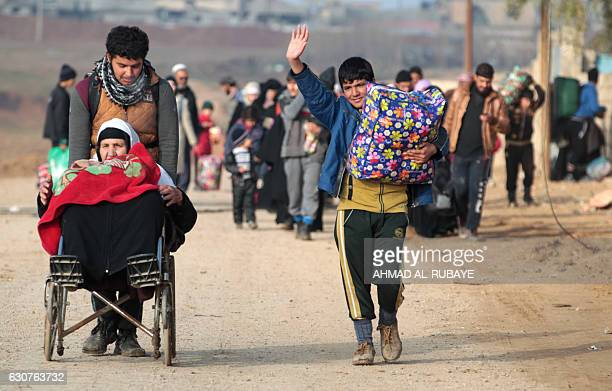 Iraqi families who were displaced from AlMethaq neighbourhood in Mosul due to the ongoing military operation against Islamic State group jihadists...