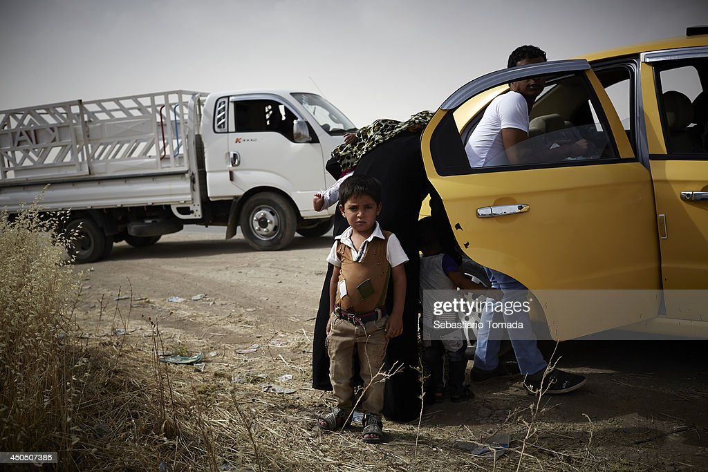 A Iraqi family fleeing violence after arrive at a Kurdish checkpoint. June 12, 2014.