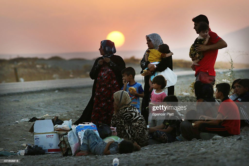 A Iraqi family who fled recent fighting near the city of Mosul prepares to sleep on the ground as they try to enter a temporary displacement camp but are blocked by Kurdish soldiers on July 3, 2014 in Khazair, Iraq. The families, many with small and sick children, have no shelter and little water and food. The displacement camp Khazair is now home to an estimated 1,500 internally displaced persons (IDP's) with the number rising daily. Tens of thousands of people have fled Iraq's second largest city of Mosul after it was overrun by ISIS (Islamic State of Iraq and Syria) militants. Many have been temporarily housed at various IDP camps around the region including the area close to Erbil, as they hope to enter the safety of the nearby Kurdish region.