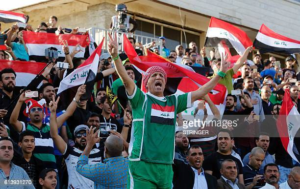 Iraqi fans cheer after the Iraqi national team scored a goal during the 2018 World Cup qualifying football match between Thailand and Iraq at the...
