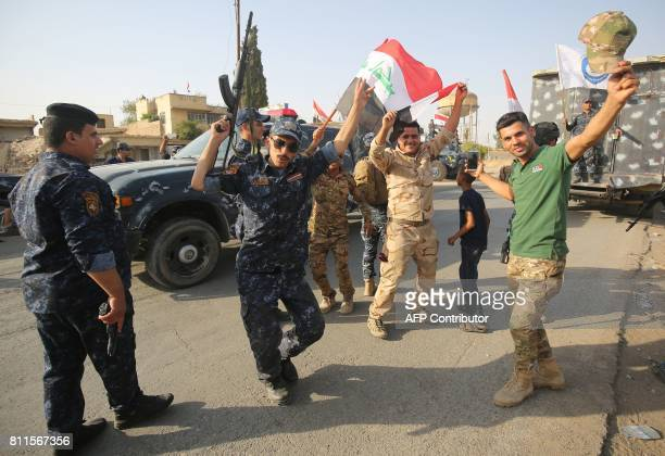 Iraqi federal police members celebrate in the Old City of Mosul on July 9 2017 after the government's announcement of the 'liberation' of the...
