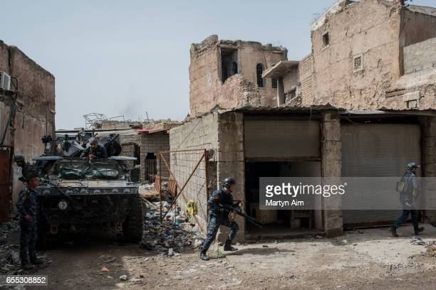 Iraqi Federal Police soldiers advance towards an Islamic State position in Bab alTob a neighbourhood in the Old City of west Mosul part of the...