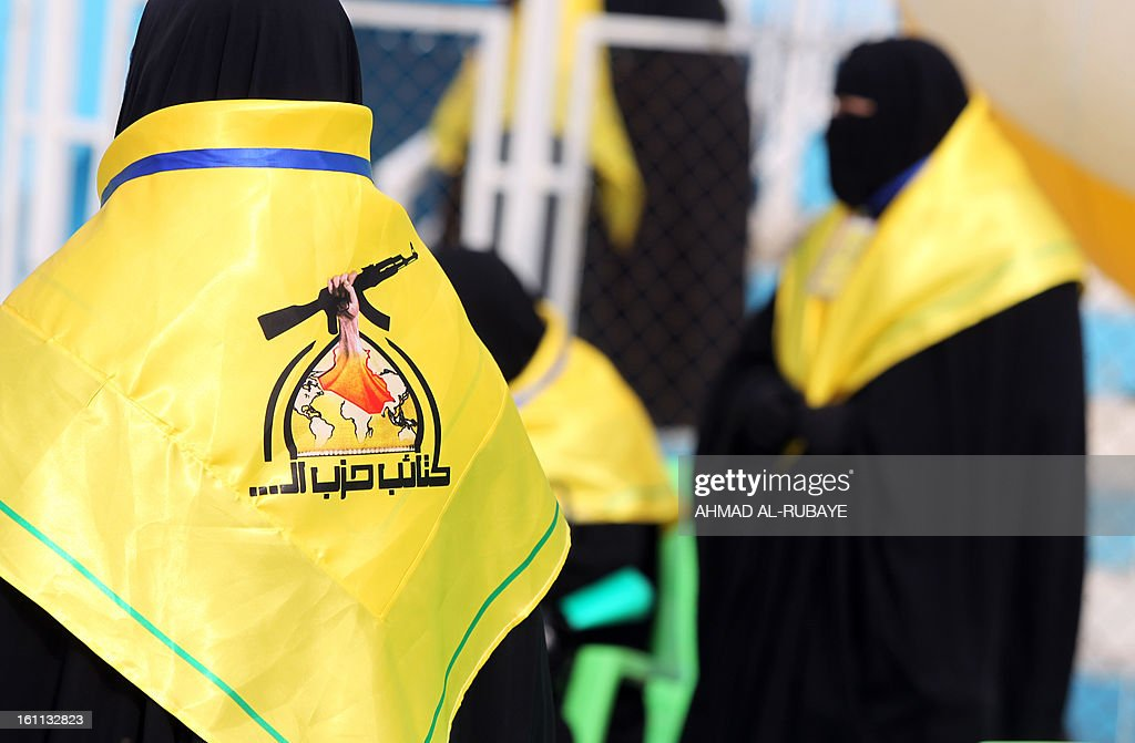 Iraqi female supporters of the Lebanese Hezbollah Shiite Muslim political party, wear the party's colours as they attend a celebration in Baghdad on February 9, 2013, to commemorate the withdrawal of US troops' from Iraq in December 2011, ending nearly nine years of the mainly US led occupation of Iraq.