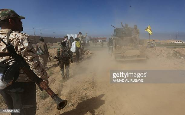 Iraqi fighters of the governmentcontrolled Popular Mobilisation advance into Tikrit 160 kms north of Baghdad to regain the city from jihadists from...