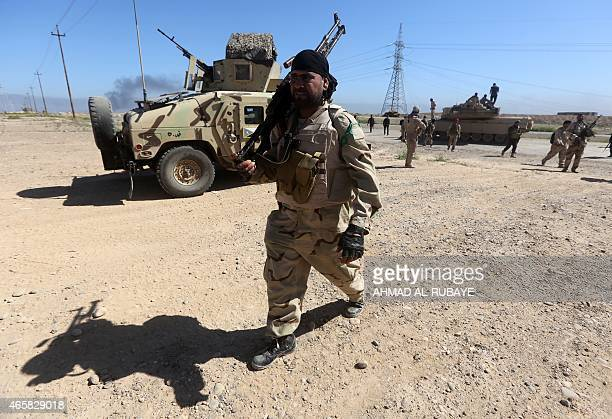 Iraqi fighters of the governmentcontrolled Popular Mobilisation units take part in a military operation on the western outskirts of the Iraqi city of...