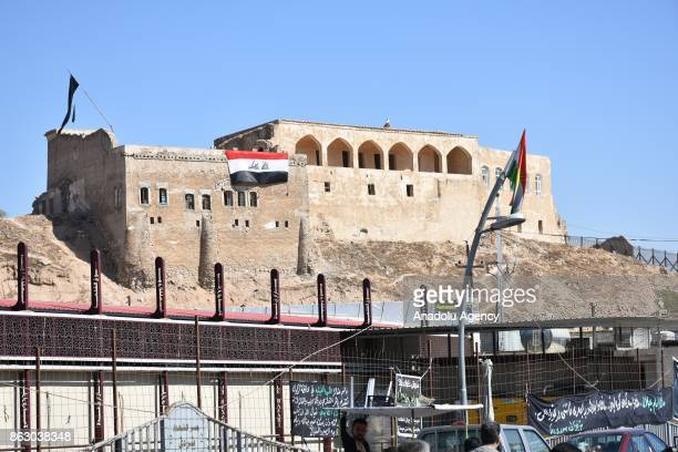 Iraqi flag waves on Kirkuk castle as the daily life turn to normal after town center of the city has been secured in Kirkuk Iraq on October 19 2017...