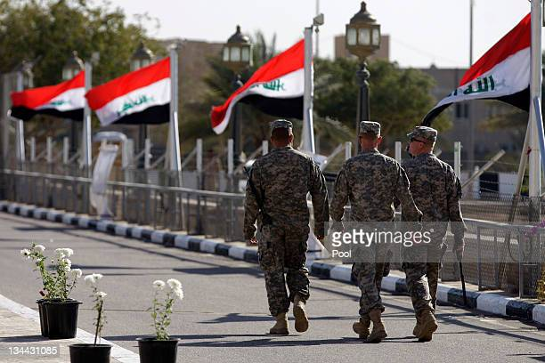 Iraqi flags wave as US soldiers leave Al Faw palace at Camp Victory one of the last American bases in this country where the US military footprint is...
