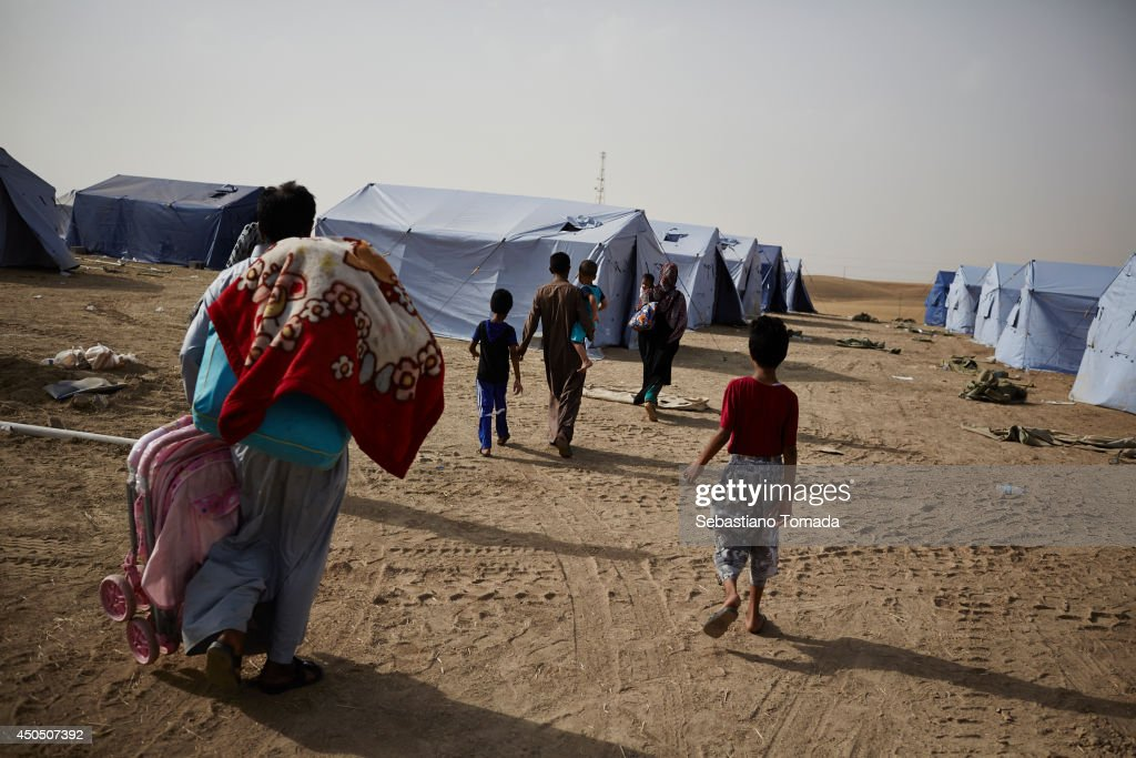 Iraqi fleeing violence arrive in a makeshift camp at a Kurdish checkpoint in Kalak after the city of Mosul was overrun by ISIS militants. June 12, 2014.