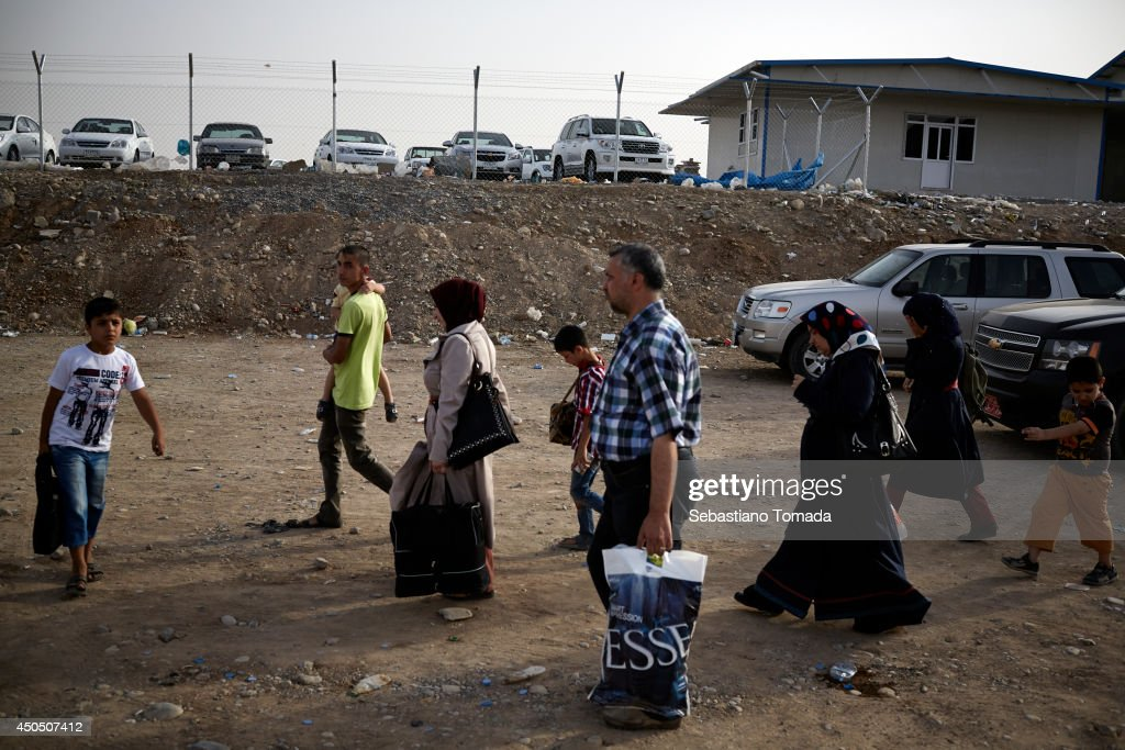 Iraqi fleeing violence cross a Kurdish checkpoint in Kalak after the city of Mosul was overrun by ISIS militants. June 12, 2014.