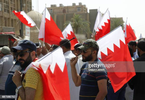 Iraqi followers of Shiite cleric Moqtada alSadr take part in a demonstration in front of the Bahraini embassy in Baghdad on May 24 2017 in solidarity...