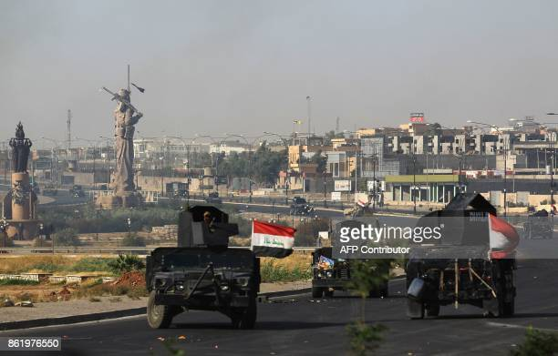 Iraqi forces advance towards the centre of Kirkuk during an operation against Kurdish fighters on October 16 2017 Iraqi forces seized the Kirkuk...