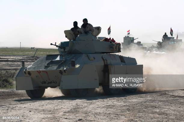 Iraqi forces armoured vehicles supported by the Hashed alShaabi paramilitaries advance towards the village of Sheikh Younis south of Mosul after the...
