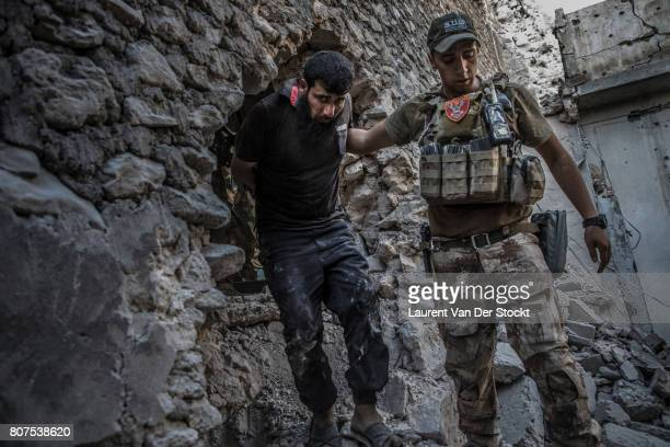 Iraqi forces arrest a man they suspect of being affiliated with the Islamic State in alNuri mosque complex on June 29 in Mosul Iraq The Iraqi Army...