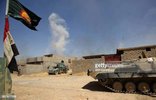 Iraqi forces backed by Shiite fighters from the Popular Mobilization Forces advance inside alNour neighbourhood in eastern Tal Afar the main...