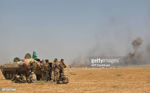 Iraqi forces backed by the Hashed AlShaabi advance towards the town of Tal Afar west of Mosul after the Iraqi government announced the beginning of...