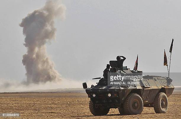 TOPSHOT Iraqi forces battle against Islamic State group jihadists in the Bajwaniyah village about 30 kms south of Mosul on October 18 2016 as they...