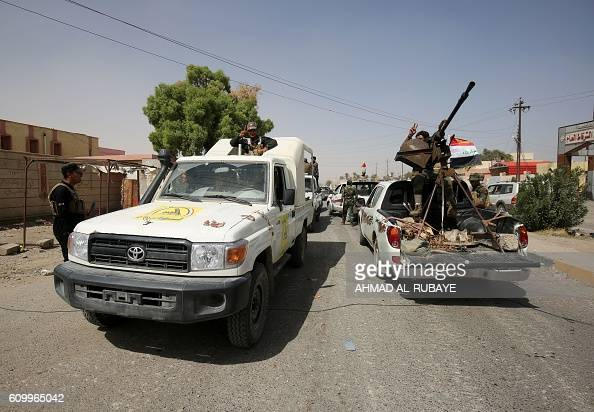 Iraqi forces celebrate in the town of Sharqat around 80 kilometres south of the city of Mosul on September 23 the day after Iraq announced that his...