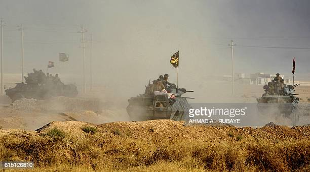 TOPSHOT Iraqi forces deploy in the area of alShourah some 45 kms south of Mosul as they advance towards the city to retake it from the Islamic State...