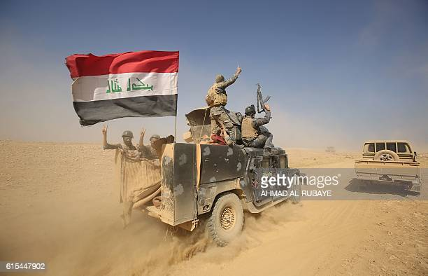 TOPSHOT Iraqi forces deploy in the Bajwaniyah village about 30 kms south of Mosul on October 18 2016 after they liberated it from Islamic State group...