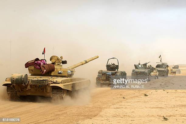 TOPSHOT Iraqi forces deploy on October 17 2016 in the area of alShurah some 45 kms south of Mosul as they advance towards the city to retake it from...