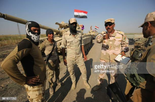 Iraqi forces discuss military tactics as they drive towards Kurdish peshmerga positions on the southern outskirts of Kirkuk on October 15 2017 The...