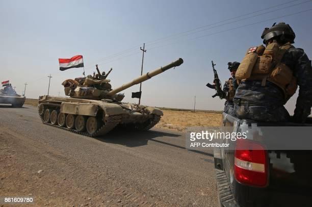 Iraqi forces drive a tank towards Kurdish peshmerga positions on October 15 on the southern outskirts of Kirkuk The presidents of Iraq and Iraqi...