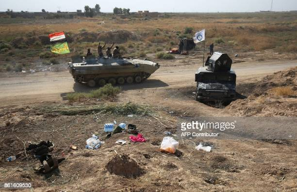 Iraqi forces drive along a river bank across from Kurdish peshmerga positions on October 15 on the southern outskirts of Kirkuk The presidents of...