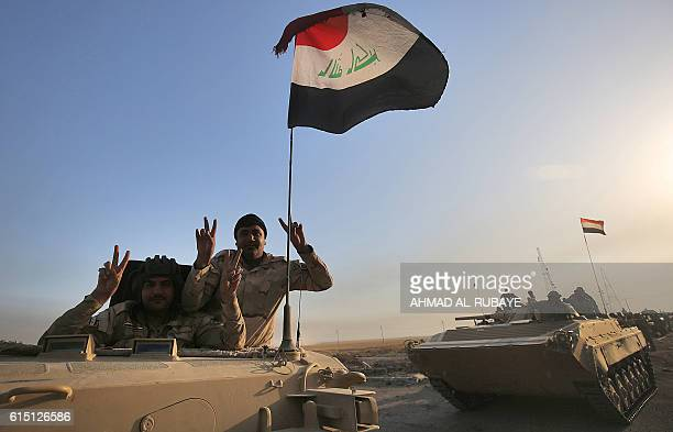 Iraqi forces drive their tanks in the area of alShourah some 45 kms south of Mosul as they advance towards the city to retake it from the Islamic...