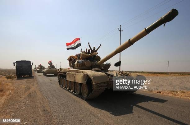 TOPSHOT Iraqi forces drive towards Kurdish peshmerga positions on October 15 on the southern outskirts of Kirkuk The presidents of Iraq and Iraqi...