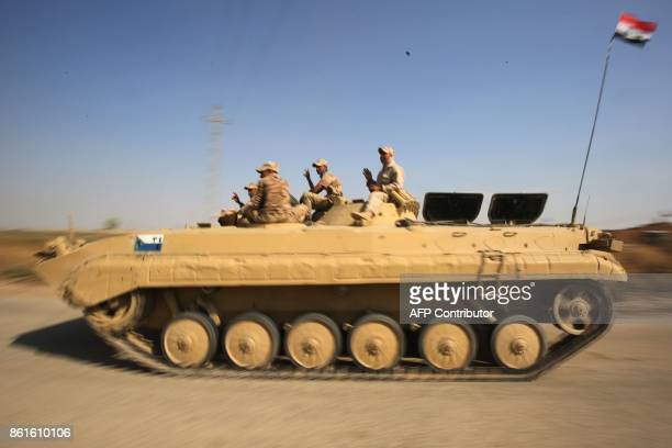Iraqi forces drive towards Kurdish peshmerga positions on October 15 on the southern outskirts of Kirkuk The presidents of Iraq and Iraqi Kurdistan...