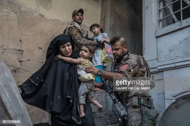 Iraqi forces evacuate a family they discovered in alNuri mosque complex on June 29 in Mosul Iraq The Iraqi Army Special Operations Forces and...