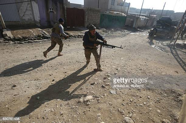 Iraqi forces fire against Islamic State group jihadists during an ongoing military operation in the AlIntisar area in eastern Mosul on January 1 2017...