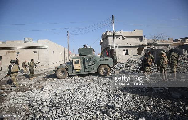 Iraqi forces gather in Mosul's eastern AlIntisar neighbourhood on December 30 during an ongoing military operation against Islamic State group...