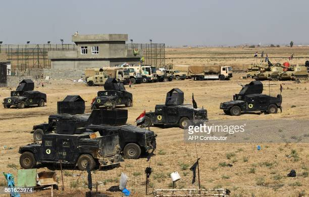 Iraqi forces gather in the area of Taza Khurmata on the southern outskirts of Kirkuk on October 15 2017 The presidents of Iraq and Iraqi Kurdistan...