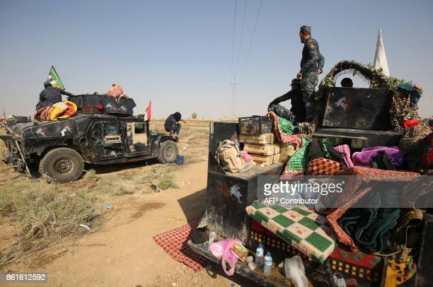 Iraqi forces gather on a river bank across from Kurdish peshmerga positions on October 15 on the southern outskirts of Kirkuk The presidents of Iraq...
