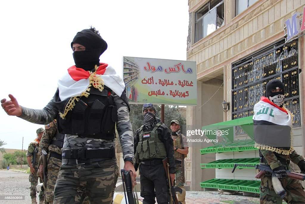 Iraqi forces including soldiers police officers Shiite militias and Sunni tribes patrol at the entrance to the Iraqi city of Tikrit on April 1 2015...