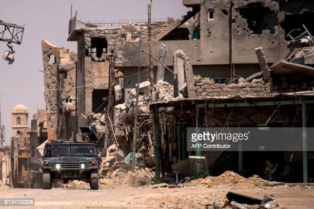 Iraqi forces patrol a street in west Mosul on July 12 2017 a few days after the government's announcement of the 'liberation' of the embattled city...