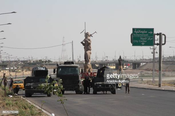 Iraqi forces patrol in the streets after they retake the control of the city center from Peshmerga forces in Kirkuk Iraq on October 16 2017 Iraqi...