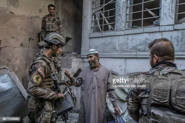 Iraqi forces question a man they suspect of being affiliated with the Islamic State in alNuri mosque complex on June 29 in Mosul Iraq The Iraqi Army...