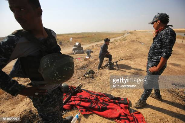 Iraqi forces set up a look out post on the opposite side of the river from a Kurdish peshmerga position on October 15 on the southern outskirts of...