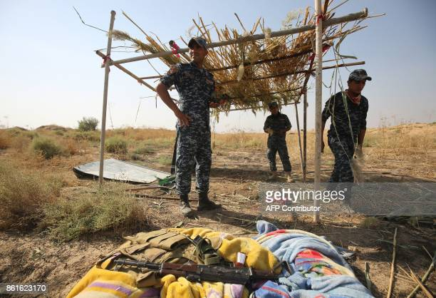 Iraqi forces set up a look out post on the opposite side of the river from a Kurdish peshmerga position on the southern outskirts of Kirkuk on...